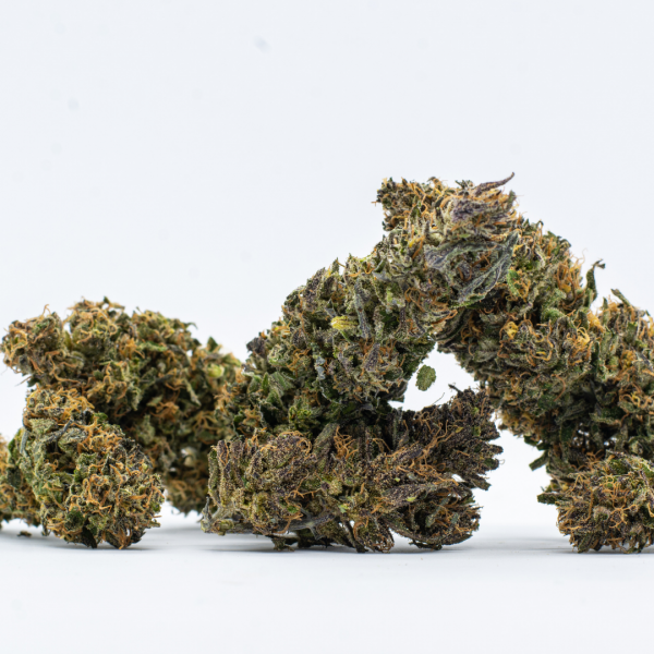 A pile of ACDC Hemp flowers on a white background
