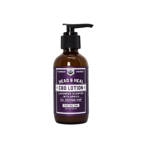 A bottle of Head & Heal's Lavender Scented CBD Lotion on a white background.